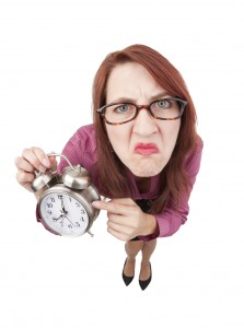 Angry Boss Lady Pointing to Alarm Clock